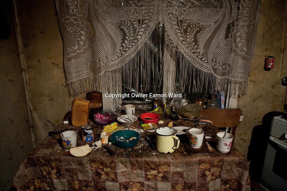 Kitchen table in the Home of a resettled family. Chernobyl's human costs are widespread affecting about seven million people.A generation later children are being born with birth defects ,heart problems and thyroid cancer.The crippled economy of Belarus has led to poverty, social problems and domestic abuse.