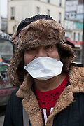 """March, 29th 2020 - Paris, Ile-de-France, France: Parisians wearing a range of masks and facial coverings in the hope of protecting themselves from the spread of the Coronavirus, during the twelfth day of near total lockdown imposed in France. A week after President of France, Emmanuel Macron, said the citizens must stay at home for at least 15 days, that has been extended. He said """"We are at war, a public health war, certainly but we are at war, against an invisible and elusive enemy"""". All journeys outside the home unless justified for essential professional or health reasons are outlawed. Anyone flouting the new regulations is fined. Nigel Dickinson"""