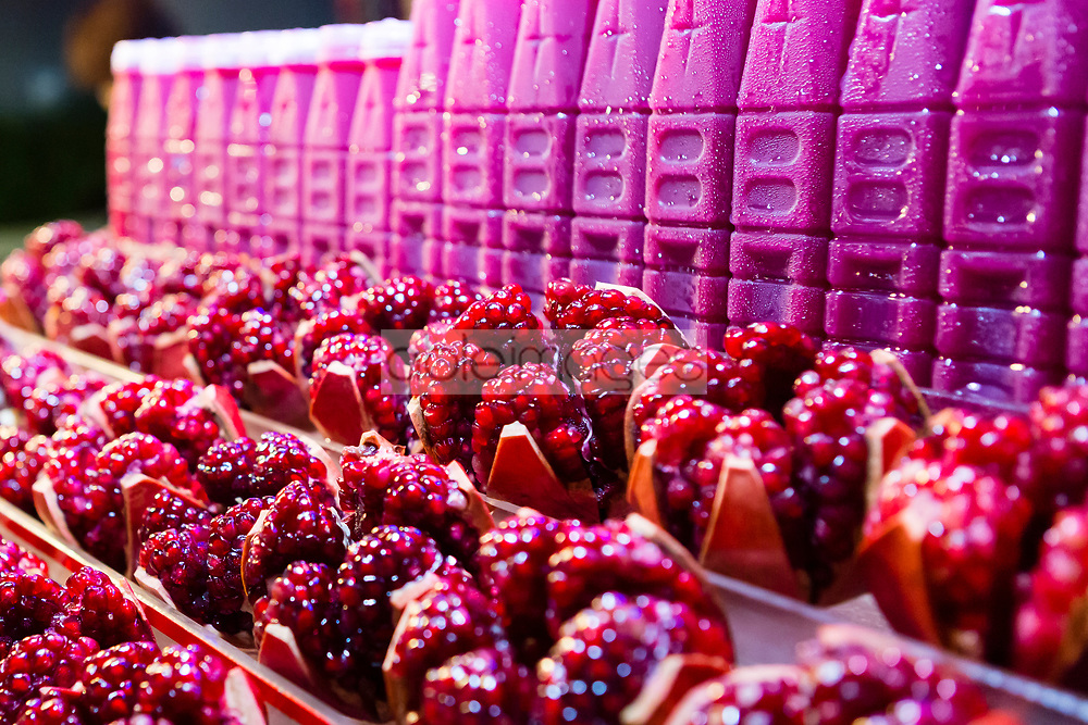 Rows of Glazed Pomegranate Seeds on Market Stall