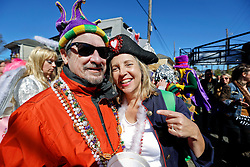 09 February 2016. New Orleans, Louisiana.<br /> Mardi Gras Day. Michelle and Gary in the French Quarter.<br /> Photo©; Charlie Varley/varleypix.com