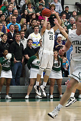 21 February 2015:  Pat Sodemann for three during an NCAA men's division 3 CCIW basketball game between the Elmhurst Bluejays and the Illinois Wesleyan Titans in Shirk Center, Bloomington IL
