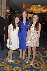 ROISIN DONNELLY The corporate marketing director and head of marketing for P&G UK and her daughters, left to right, JULIET HUGHES and CORDELIA HUGHES at the 20th CEW (UK) Achiever Awards 2012 - celebrating two decades of women, passion, beauty, held at the Hilton, park Lane, London on 16th October 2012.