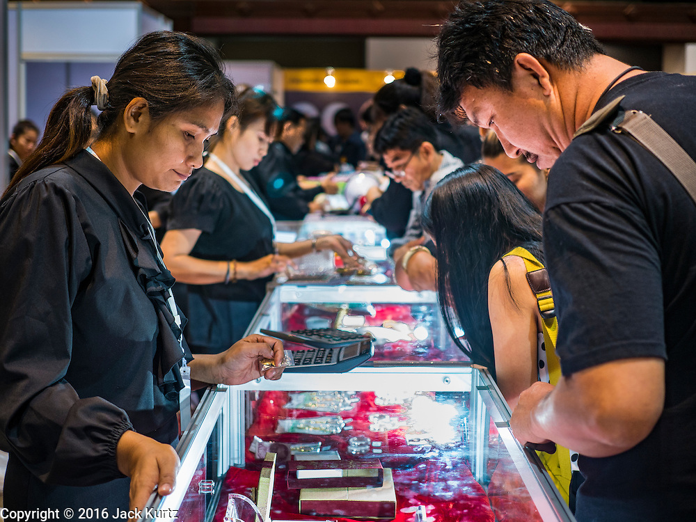 22 DECEMBER 2016 - BANGKOK, THAILAND:  People shop for commemorative  coins honoring the late King at Queen Sirikit Convention Center. The Thai treasury department sold commemorative coins to honor Bhumibol Adulyadej, the Late King of Thailand, at Queen Sirikit Convention Center in Bangkok. Thecoins celebrate milestones in the beloved monarch's life. PHOTO BY JACK KURTZ