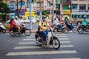 27 MARCH 2012 - HO CHI MINH CITY, VIETNAM:   Motor scooter traffic in Ho Chi Minh City, Vietnam. As Vietnam's economy has started to boom people have moved from bicycles to motor scooters for personal transport. Ho Chi Minh City, which used to be known as Saigon, is the largest city in Vietnam and the commercial hub of southern Vietnam.     PHOTO BY JACK KURTZ