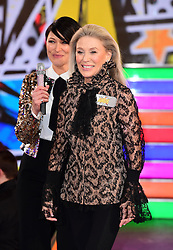 Angie Best (right) enters the Celebrity Big Brother house at Elstree Studios in Borehamwood, Herfordshire, during the latest series of the Channel 5 reality TV programme.