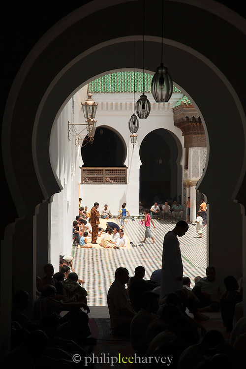 People pray in the Kairaouine Mosque in the medina of Fes, Morocco