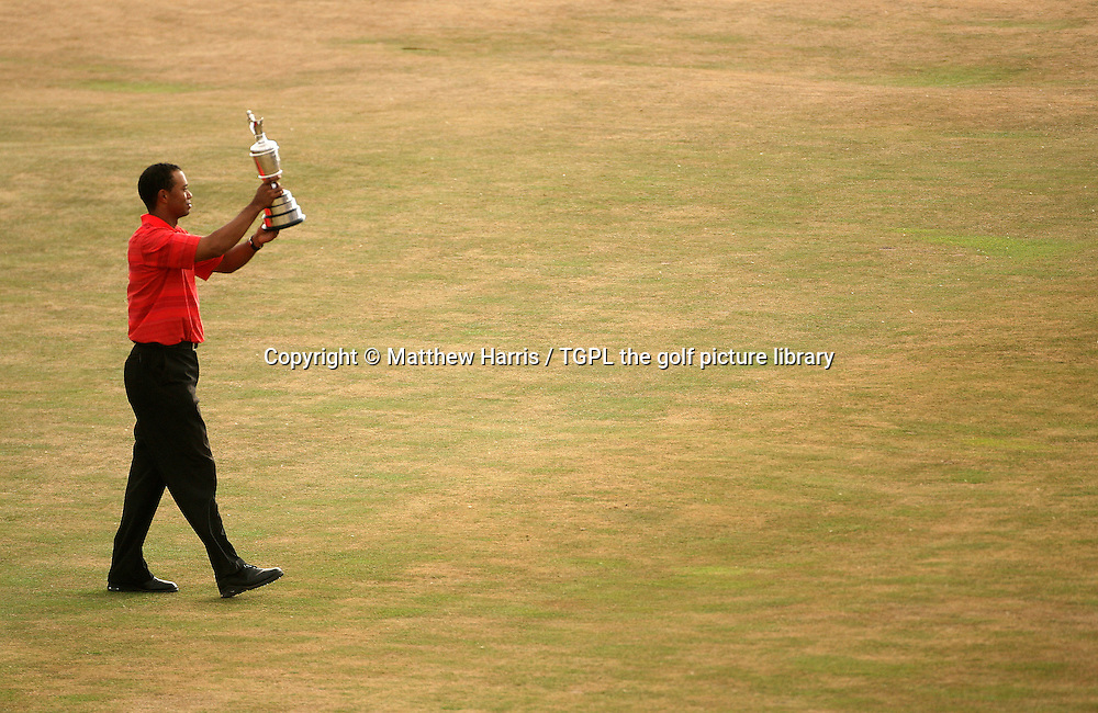 Tiger WOODS (USA) walks across 18th green with the famous claret jug trophy during fourth round The Open Championship 2006,Royal Liverpool, Hoylake, Wirral, England.