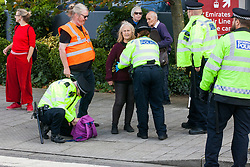 London, UK. 4 September, 2019. Metropolitan Police offices carry out a stop and search on an activist protesting outside ExCel London on the third day of a week-long carnival of resistance against DSEI, the world's largest arms fair. The third day's protests were organised by the Campaign for Nuclear Disarmament (CND) and Trident Ploughshares.