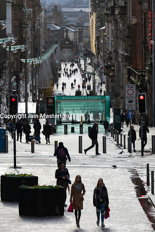 Glasgow, Scotland, UK. 21 November 2020. Views of Saturday afternoon in Glasgow city centre on first day of level 4 lockdown. Non essential shops and businesses have closed. And streets are very quiet. Pictured; View of Buchanan Street which is much quieter than usual .Iain Masterton/Alamy Live News