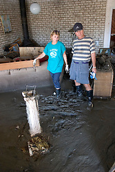 08 Sept 2005.  New Orleans, Louisiana. Hurricane Katrina aftermath. <br /> Venetian Isles in East New Orleans, where the tidal surge washed over the land and devastated homes and property. John and Peggy Lala survey the damage of their mud filled flood ravaged home.<br /> Photo; ©Charlie Varley/varleypix.com