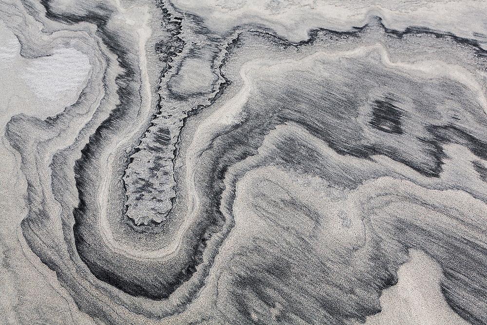 Sedimentary patterns in the sand on Horseid Beach, Moskenesoya, Lofoten Islands, Norway.