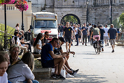 Licensed to London News Pictures. 05/09/2021. London, UK. Members of the public enjoy the warm sun along the Thames at Richmond, south-west London as weather forecaster predict a mini-heatwave for September from today with temperatures hitting over 27c tomorrow and throughout the week. Photo credit: Alex Lentati/LNP