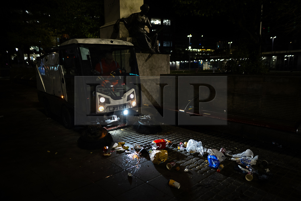 © Licensed to London News Pictures. 13/04/2021. Manchester, UK. Rubbish is swept up in Piccadilly Gardens at the end of a night out in Manchester City Centre , as government restrictions to control the spread of Coronavirus are eased across the UK. Pubs, restaurants, hairdressers, gyms and non essential retailers are now permitted to serve customers within restrictions. Photo credit: Joel Goodman/LNP