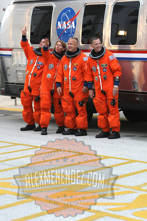 The space shuttle Atlantis astronauts left to right, mission specialists Rex Walheim, Sandy Magnus, pilot Doug Hurley and commander Chris Ferguson wave after leaving the operations and check-out building on their way to the pad at the Kennedy Space Center Friday, July 8, 2011, in Cape Canaveral, Fla. Shuttle Atlantis is scheduled to launch on Friday, July 8 and is the 135th and final space shuttle launch for NASA..  (AP Photo/Alex Menendez)