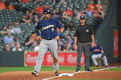 March 26, 2018 - Houston, TX, U.S. - HOUSTON, TX - MARCH 26: Milwaukee Brewers catcher Manny Pina (9) prepares to lead off before scoring on a hit during the game between the Milwaukee Brewers and Houston Astros at Minute Maid Park on March 26, 2018 in Houston, Texas. (Photo by Ken Murray/Icon Sportswire) (Credit Image: © Ken Murray/Icon SMI via ZUMA Press)