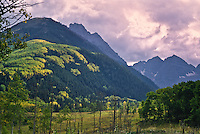 Pyramid Peak and Maroon Bells during the autumn season.  Elk Mountains, Colorado.  USA