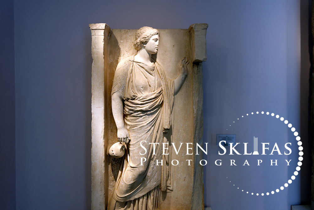Large grave relief of a Hydriaphoros from 350 BC. Kerameikos Museum. Athens. Greece. Hydriaphoroi (women carrying hydriae) took part in religious processions. It was built into the enclosure wall of the Hekateion of Roman times.