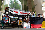 Demonstrators protest outside the AFP building during the AFP Stop Training Killers protest organised by Make West Papua Safe organisation. The organisation believes the AFP trains with Indonesian riot police BriMob and counter-terrorist police D88, who are reportedly notorious killers in West Papua, responsible for execution-style murders, torture and other crimes. (Photo by Mikko Robles/Speed Media)