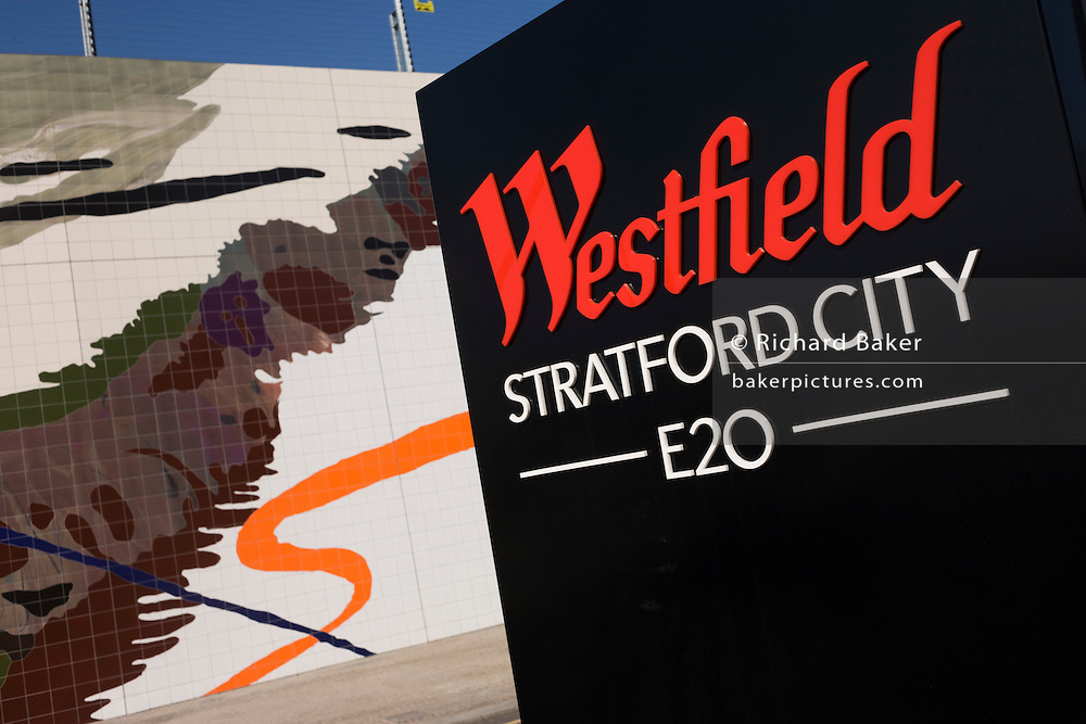 Boundary sign of the Westfield City shopping centre in Stratford, home of the 2012 Olympics. Situated on the fringe of the 2012 Olympic park, Westfield hosted its first day to thousands of shoppers eager to see Europe's largest urban shopping centre. The £1.45bn complex houses more than 300 shops, 70 restaurants, a 14-screen cinema, three hotels, a bowling alley and the UK's largest casino. It will provide the main access to the Olympic park for the 2012 Games and a central 'street' will give 75% of Olympic visitors access to the main stadium so retail space and so far 95% of the centre has been let. It is claimed that up to 8,500 permanent jobs will be created by the retail sector.