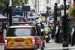 © Licensed to London News Pictures. 07/09/2017. London, UK. Protestors gather at the gates to Downing Street as prime minister Theresa May leaves to head to the Houses of Parliament in London as parliament debates the EU Withdrawal Bill. A vote will take place in parliament early next week to decide of EU laws will be enshrined in UK law as part of Brexit. Critics of the bill have said it will let government ministers grab powers from parliament. Photo credit: Ben Cawthra/LNP