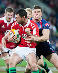 © Licensed to London News Pictures. 25/6/2013. Rob Kearney gets tackled by Jason Woodward during the British & irish Lions tour match between Melbourne Rebels Vs British & Irish Lions at AAMI Park, Melbourne, Australia. Photo credit : Asanka Brendon Ratnayake/LNP