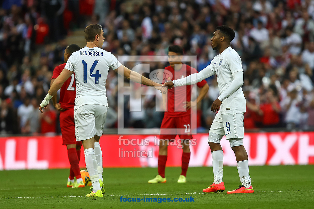 Daniel Sturridge of England celebrates with teammate Jordan Henderson of England after scoring his side's first goal during the International Friendly match at Wembley Stadium, London<br /> Picture by Daniel Chesterton/Focus Images Ltd +44 7966 018899<br /> 30/05/2014