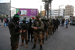 May 12, 2019 - Gaza City, Gaza Strip, Palestinian Territory - Palestinian militants of Ezzeddin al-Qassam brigades, loyal to Hamas movement, and Al-Quds brigades, loyal to Islamic Jihad movement, patrol in a street. Palestinian officials said Israel had agreed to ease its crippling decade-long blockade of the impoverished enclave in exchange for calm  (Credit Image: © Ashraf Amra/APA Images via ZUMA Wire)