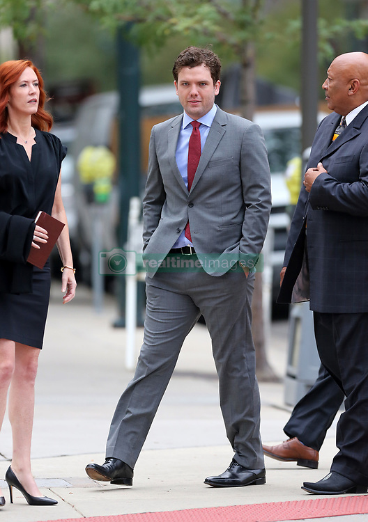 """Taylor Swift v David Mueller trial in Denver day five arrivals at court. Pictured Taylor Swift's brother, Austin, publicist Tree Paine and security detail leaving the Ritz-Carlton hotel to walk to the nearby courthouse. Also sign in a nearby office window that reads """"FEARLESS."""". 11 Aug 2017 Pictured: Taylor Swift's brother, Austin Swift. Photo credit: Leigh Green/MEGA TheMegaAgency.com +1 888 505 6342"""