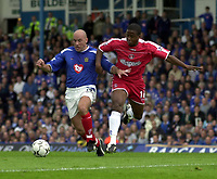 Picture: Henry Browne.<br />Date: 04/10/2003.<br />Portsmouth v Charlton Athletic FA Barclaycard Premiership.<br /><br />Kevin Lisbie of Charlton and Pompey's Steve Stone battle it out