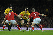 Australia's Drew Mitchell © runs in to Scott Andrews (3) and Gethin Jenkins of Wales .Dove Men, autumn international test, Wales v Australia at the Millennium Stadium in Cardiff on Sat 1st Dec 2012. pic by Andrew Orchard, Andrew Orchard sports photography,