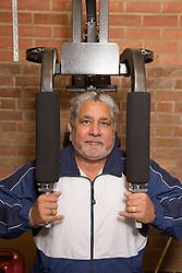 Older man exercising at his home gym,