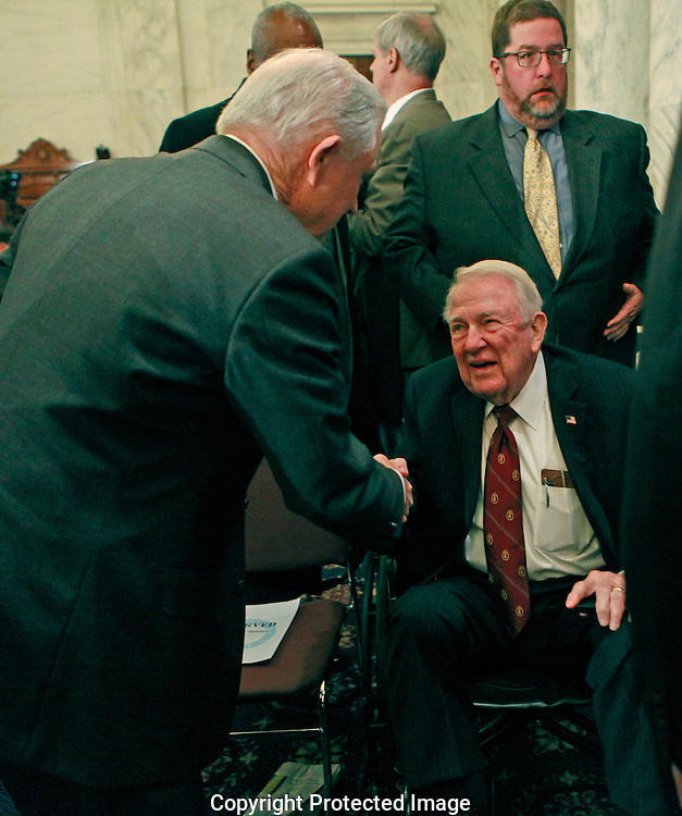 Senator Jeff Sessions talks to former Attorney General Ed Meese at the lunch break of his confirmation hearing to become Attorney General.  The hearing was held in the Caucus Room of the Russell Senate Office Building on January 10, 2017.<br /> <br /> Photo by Dennis Brack