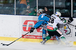 Nejc Berlisk (HDD Tilia Olimpija, #28) vs Reid Cashman (EHC Liwest Black Wings, #10) during ice-hockey match between HDD Tilia Olimpija and EHC Liwest Black Wings Linz in 37th Round of EBEL league, on Januar 9, 2011 at Hala Tivoli, Ljubljana, Slovenia. (Photo By Matic Klansek Velej / Sportida.com)