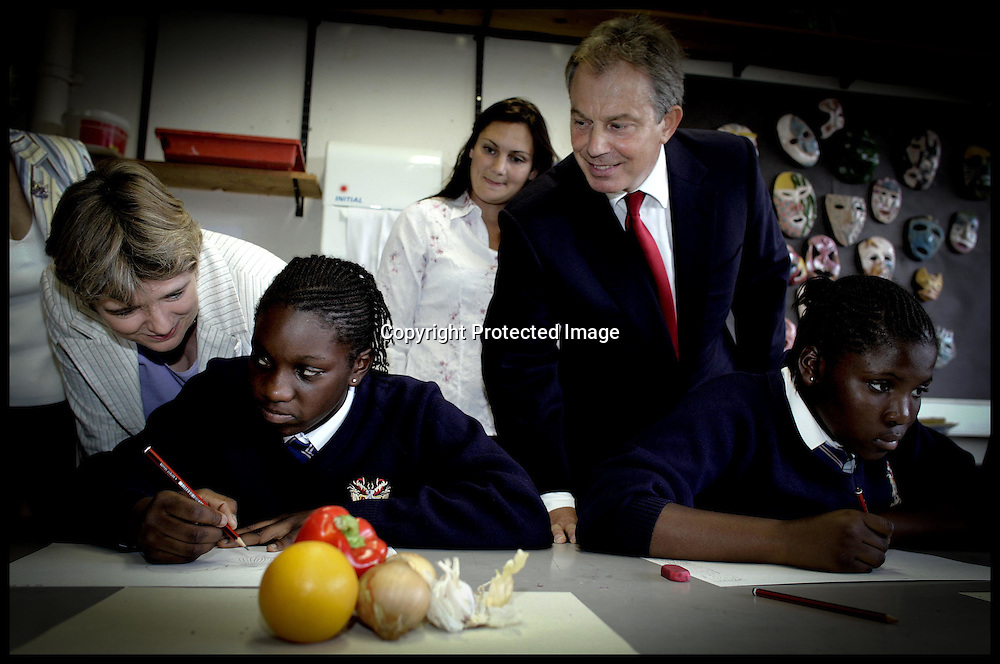 The Prime Minister Tony Blair and Ruth Kelly look at year 8 pupils artwork on a visit to Haberdashers Aske's Hatcham College(Academy),London,Monday 12th September 2005.PA Photo Andrew Parsons POOL