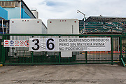 """2016/05/26 - Caracas, Venezuela: Polar beer factory gate in Caracas with a sign """"36 days wanting to produce but without raw material, we can't!!!"""" Polar is the biggest food conglomerate in Venezuela. (Eduardo Leal)"""
