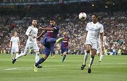 August 16, 2017 - Madrid, Spain - Luis Suarez shoots on goal between Sergio Ramos and Varane. Real Madrid defeated Barcelona 2-0 in the second leg of the Spanish Supercup football match at the Santiago Bernabeu stadium in Madrid, on August 16, 2017. (Credit Image: © Antonio Pozo/VW Pics via ZUMA Wire)