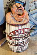 """A novel trash bin is labeled """"Mr. Big Mouth swallows everything, paper, steel, glass"""" at the Bridgeton Mill in Bridgeton Historic District, Indiana. Bridgeton Mill was established 1823, rebuilt 1870, and is the oldest continuously operating mill west of the Allegheny Mountains. The mill grinds wheat into flour and corn into meal with 200 year-old French Buhr stones."""