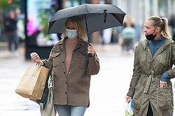 © Licensed to London News Pictures 24/05/2021. Bexleyheath, UK. People out and about in the rainy weather shopping this afternoon in Bexleyheath, South East London. Some people are wearing masks to protect themselves against Coronavirus. Photo credit:Grant Falvey/LNP