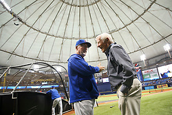 September 19, 2017 - St. Petersburg, Florida, U.S. - WILL VRAGOVIC   |   Times.Chicago Cubs manager Joe Maddon (70) talks with Dick Vitale before the start of the game between the Chicago Cubs and the Tampa Bay Rays at Tropicana Field in St. Petersburg, Fla. on Tuesday, Sept. 19, 2017. (Credit Image: © Will Vragovic/Tampa Bay Times via ZUMA Wire)