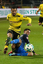 DORTMUND, Dec. 17, 2017  Florian Grillitsch of Hoffenheim and Jeremy Toljan (L) of Dortmund battle for the ball during the Bundesliga match between Borussia Dortmund and TSG 1899 Hoffenheim at Signal Iduna Park on December 16, 2017 in Dortmund, Germany. Dortmund won 2-1. (Credit Image: © Joachim Bywaletz/Xinhua via ZUMA Wire)