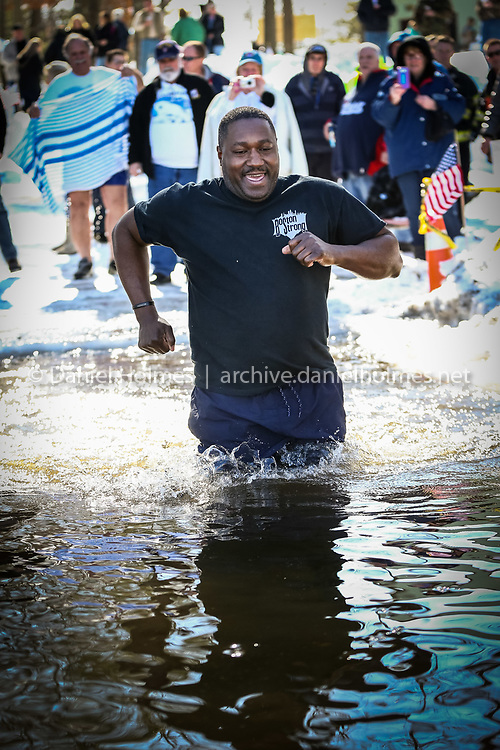 """(2/8/14, NATICK, MA) Floyd Francis plunges into the icy waters of Lake Cochituate during the AMVETS Department of Massachusetts' """"Passion Plunge"""" in Natick on Saturday. The Passion Plunge is a fundraiser for the Special Olympics of Massachusetts. Daily News and Wicked Local Photo/Dan Holmes"""