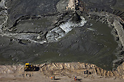 Nederland, Zuid-Holland, Monster, 18-03-2009; Versterking van de kust van Delfland tussen Ter Heijde en 's-Gravenzande door middel van zandsuppletie. Omdat het zand hoog op het strand opgespoten moet worden, zijn er dammen aangelegd om het zand tegen te houden, het overtollig water loopt naar opzij terug naar zee. Boven in het midden de pijp waarmee opgespoten wordt, de bulldozer verspreid het zand. De Delflandse kust is een van de 'Zwakke Schakels' in de zeewering..The coast of Delfland, between Hoek van Holland and The Hague, is been between strengthened by means of sand-supplementation. Bulldozers have made a dams to keep the new sand in place when it is sprayed high on the beach, the surplus of water flows back to the sea. .Swart collectie, luchtfoto (toeslag); Swart Collection, aerial photo (additional fee required); .foto Siebe Swart / photo Siebe Swart