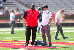Sep 4, 2021; College Park, Maryland, USA; Maryland Terrapins head coach Mike Locksley talks with West Virginia Mountaineers head coach Neal Brown prior to their game at Capital One Field at Maryland Stadium. Mandatory Credit: Ben Queen-USA TODAY Sports