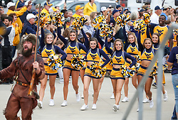 Sep 8, 2018; Morgantown, WV, USA; The West Virginia Mountaineers cheerleaders lead the team through fans as they arrive to the field before their game against the Youngstown State Penguins at Mountaineer Field at Milan Puskar Stadium. Mandatory Credit: Ben Queen-USA TODAY Sports