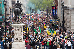 © Licensed to London News Pictures. 29/05/2021. London, UK. Hundreds of thousands of pro-freedom, pro-democracy,  anti-dictatorship protesters march through London to protest against the corruption of the UK government and mainstream media lies, propaganda and fear-mongering. Protesters say that they are against the fraudulent removal of people's inalienable rights through measures brought in under the unlawful Coronavirus Act 2020 such as lockdown, mask-wearing, social-distancing, vaccine passports, track and trace etc. Photo credit: Graham M. Lawrence/LNP