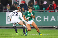 Ireland player Sene Naoupu looks to avoid an English tackler in the second half during the Women's 6 Nations match between Ireland Women and England Women at Energia Park, Dublin, Ireland on 1 February 2019.