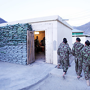 """Jon Rose of Waves for Water works with Captain Michael Brabner of 2nd Battalion, 27th Infantry Regiment """"The Wolfhounds"""" setting up water filtration systems in Forward Operating Base Bostick, Kunar Province of Eastern Afghanistan."""
