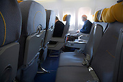 many empty seats in a commercial passenger airplane while in the air