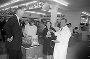 08/07/1965 <br /> 07/08/1965<br /> 08 July 1965<br /> Opening of Powers Supermarket in Ballyfermot.  Picture shows Mr. H. Hall of Powers Supermarket, presenting the free chicken to Mrs Agnes Farrell of Ballyfermot on opening day. A free chicken was given to each purchase of goods over £2 value.
