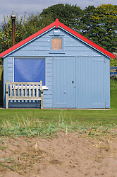 Blue wooden fisherman's hut bench window shed